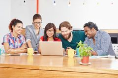 Startup meeting with computer. Using internet for social media Stock Image
