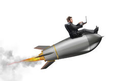 Startup of a new company. Concept of new business. Businessman holding a small rocket. Startup of a new company concept Stock Images