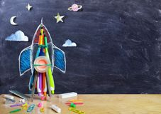 Startup - Rocket Drawing With School Supplies. On Table stock photo