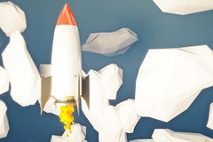 Startup rocket going up Stock Photo