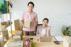 Startup small business owner at home . freelance couple seller check product order, packing goods for delivery to customer. royalty free stock photography