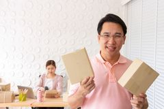Startup small business owner at home . freelance couple seller show box product order, packing goods for delivery to customer. stock photo