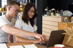 Startup small business owner working with computer at workplace. Freelance couple seller check product order for delivery to customer.  Online selling, e Stock Image