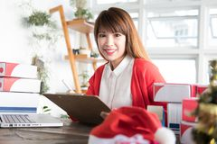 Startup small business owner working with computer at workplace. Start up small business owner working with computer at workplace. freelance woman seller check Stock Images