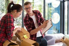 Startup small business owner working with computer at workplace. Freelance men & women seller check product order, packing goods for delivery to customer Royalty Free Stock Photos
