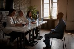 Startup team having a job interview with candidate. In the office stock photos