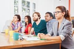 Startup team in a presentation. Startup business team in a seminar presentation Stock Image