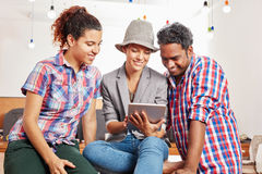 Startup team with tablet using social media Stock Images