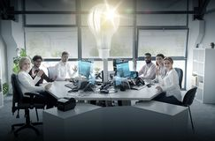 Business team waving hands at office. Startup, technology and people concept - business team with computers waving hands at office royalty free stock images