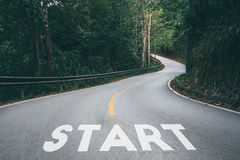 Startup to success business printed on road leading toward Royalty Free Stock Photo