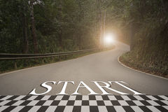 Startup to success business printed on road leading towards Stock Photography