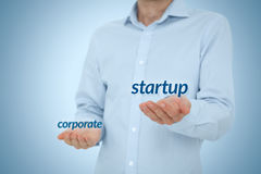 Startup versus corporate Stock Images