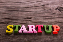 Startup word made of wooden letters Stock Photo