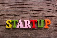 Startup word made of wooden letters Stock Image