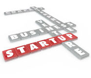 Startup Word Tiles Business Company Enterprise. Startup words on letter tiles including company, enterprise, business and venture to illustrate starting a new Stock Photo