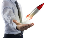 Startup working enterprise. Businessman holding a small rocket. Startup working enterprise concept Royalty Free Stock Photo