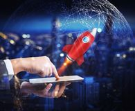 Startup working enterprise. 3D rendering. Businessman launches rocket from the mobile phone. 3D Rendering stock illustration