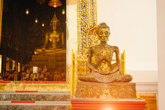 starving Buddha statue with thai art architecture in church Wat Suthat temple. Royalty Free Stock Photo