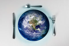 Starving Planet. Planet earth on a plate for world hunger Royalty Free Stock Image