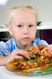 Starving young girl eating Royalty Free Stock Image