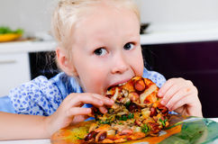 Starving young girl eating Stock Photo