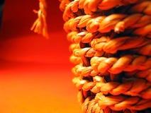 Starw basket. Close up of Straw basket against orange royalty free stock photo