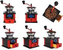Stary antykwarski drewniany czarny i czerwony kawowy ostrzarz, kawowe fasole Zdjęcie Royalty Free