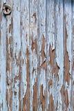 Stary błękitny drzwi z farbą szczerbi się daleko Obraz Royalty Free
