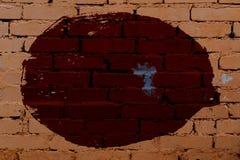 Stary barwiony tło nierówny okrąg na ścianie z cegieł fotografia royalty free