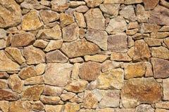 Stary beżowy duży kamiennej ściany tła tekstury zakończenie up fotografia royalty free