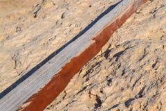 Stary blok rzucający od morza brzeg drewno Brown inside zdjęcie stock