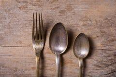 Stary cutlery na drewnianym stole Zdjęcie Stock