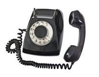 Stary czerń telefon odizolowywający Fotografia Royalty Free