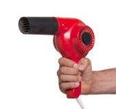 Stary czerwony hairdryer w ręce Obrazy Royalty Free