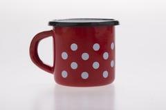 Stary czerwony metalu kaffe kubek Fotografia Royalty Free
