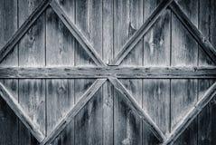 Stary drewniany drzwi wzmacniający z promienia tłem Zdjęcia Stock