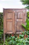 Stary drewniany okno w ogródzie Zdjęcie Royalty Free