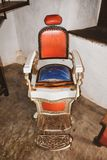 Stary fryzjera męskiego krzesło, rocznika tło zdjęcie royalty free