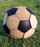 Stary futbol na trawie Zdjęcia Stock