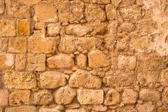 Stary i wietrzejący kamiennej ściany tło, Obraz Royalty Free