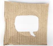 Stary kartonu papier z mowa bąbla dziurą fotografia stock