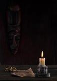 Stary manuskrypt i świeczka Zdjęcia Royalty Free