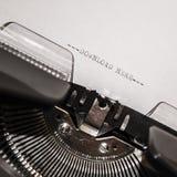 Stary maszyna do pisania z teksta ściąganiem tutaj zdjęcie stock