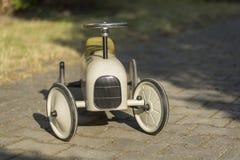 Stary metalu samochód dla dzieci od xix wiek Zdjęcie Royalty Free