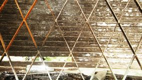 Stary okno z metali barami i drewnianymi żaluzjami fotografia royalty free