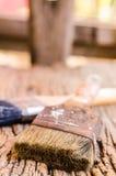 Stary paintbrush na drewnianym tle Obraz Stock