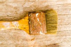 Stary paintbrush na drewnianym tle, rocznik Obrazy Stock