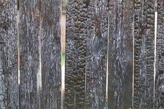 Stary palący drewniany ogrodzenie Zdjęcia Royalty Free