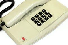 Stary prosty biurowego biurka telefon i kabel Fotografia Stock