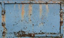 Stary rdzewiejący metalu talerz z nitami Fotografia Stock